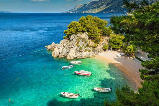 Tropical bay and beach with motorboats, Brela, Dalmatia region, Croatia