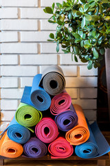Pile of colorful yoga mats forming Christmas tree