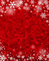 Christmas decoration with snowflakes on defocused red background.