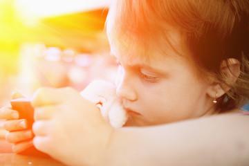 Social Media addiction. Little baby girl  holding phone (psychological problems, media mania, education)