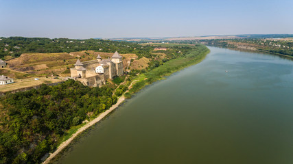 Aerial view of Khotyn medieval castle on the green hill above the river.