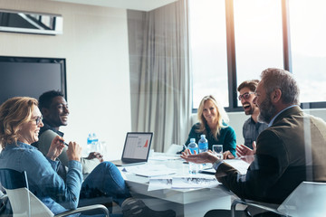 Business people having casual discussion during meeting