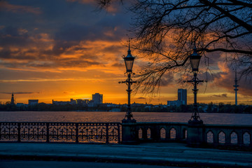 sunset panorama over the lake Alster into the city of Hamburg Germany