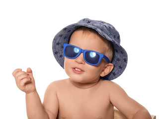 Cute little baby wearing sunglasses and hat, isolated on white