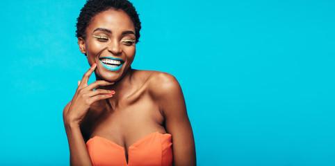 Beautiful smiling woman with vivid makeup