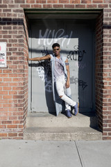 Young man posing in a doorway