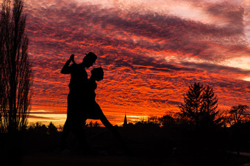 Dance couple dancing at sunset, silhouette only