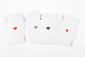 Set of card aces on white background. Ace of hearts, ace of clubs, ace of spades and ace of diamonds isolated on white background.