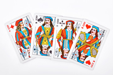 Four jacks from playing cards. Jack of diamond, jack of spades, jack of clubs and jack of hearts isolated on white background. Playing cards on white background.