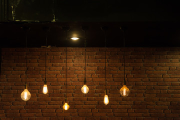 Light bulbs on brick wall