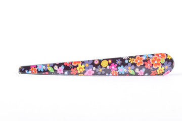 Metal clip in floral print. Female hair accessory isolated on white bacground.