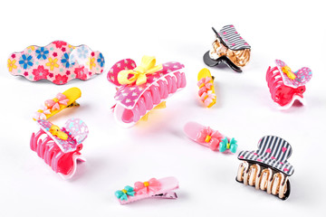 Collection of hair clips for kids. Cute girls hairpins on white background. Set of hair accessories for little girls.