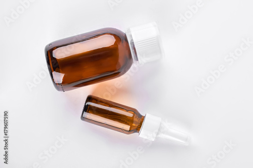 Brown glass bottles with medicine  Amber bottles of big and medium