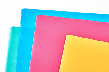 Colored paper folders close up. Set of blank multicolored envelopes for documents, cropped image. Paper work and stationery concept.