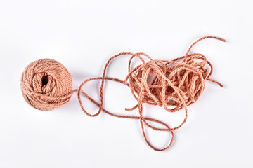 Ball of brown yarn on white background. Ball of yarn isolated on white background. Ball of knitting thread.