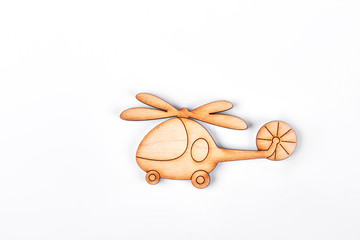 Cartoon toy helicopter, white background. Carved wooden helicopter toy isolated on white background.