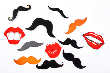 Set of fake moustache and lips. Mustaches and lips masks for carnival, isolated on white background. Wedding or party concept.