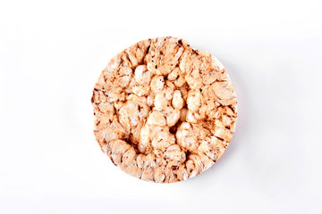 Puffed whole grain crispbread. Round wheat and buckwheat crispbread isolated on white background, top view. Dietary and healthy cookie.