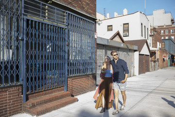 Young couple walking on street