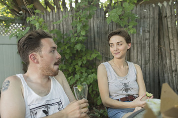 Young couple at backyard party