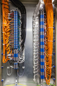 Low-voltage cabinet, non-combustible cable for a fire alarm system. Connected the cable through the terminals in the mounting cabinet.