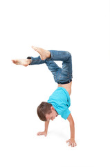 Young boy doing handstand