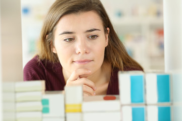 Customer choosing medicines in a pharmacy