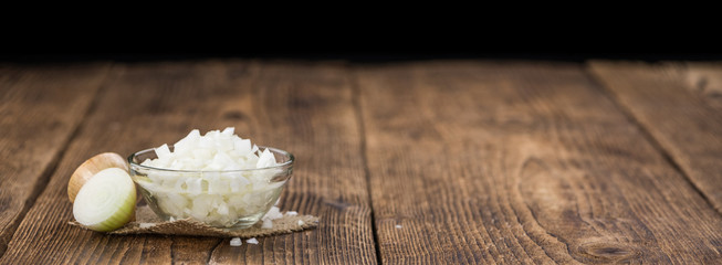 Fresh made Chopped white onions on a rustic background