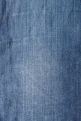 Close up shot of blue worn denim jeans fabric