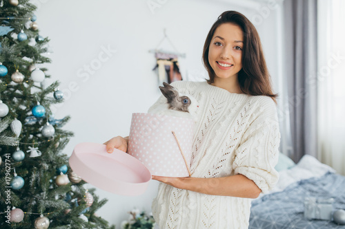 """A happy, stylish and beautiful girl opened Christmas ..."