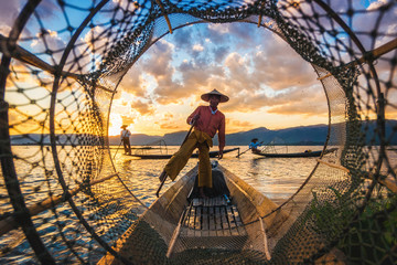 Inle Lake Intha fishermen at sunset in Myanmar (Burma).