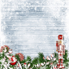 Christmas decor with a nutcracker and candy cane. with firtree on snow background