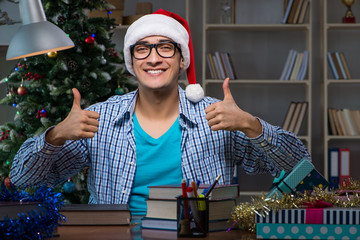Young man working at home on christmas day