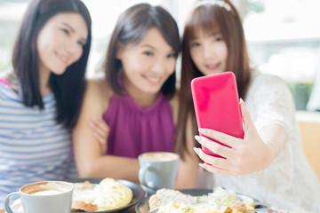 happy woman friends in restaurant