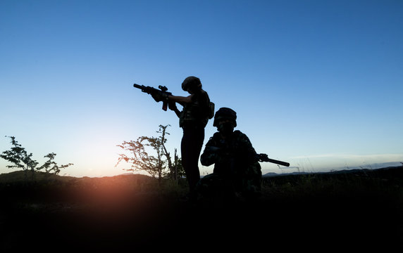 Silhouette women and man soldier