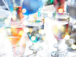 Cocktail glasses at christmas festive party abstract background.
