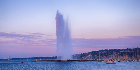 Picture of Jet d'Eau fountain and harbor at evening in Geneva, Switzerland.