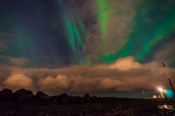 Northern lights Aurora Borealis above landscape in Iceland with