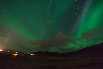 Northern lights Aurora Borealis above landscape in Iceland