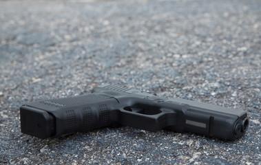 Handgun Lays on the City Pavement