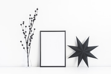 Christmas composition. Black frame and christmas decor on white background. Front view, mock up, copy space