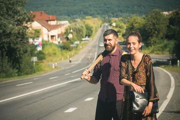Couple of hikers happy smile on asphalt road