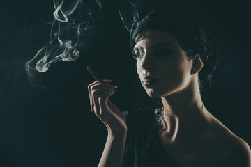 photo noir, retro woman silhouette in smoke.