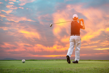silhouette golfer playing golf during beautiful sunset.