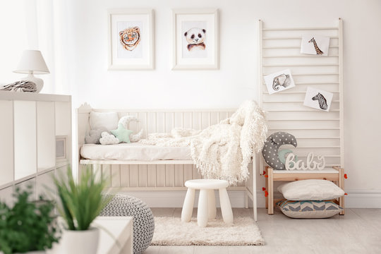 Baby bedroom decorated with pictures of animals