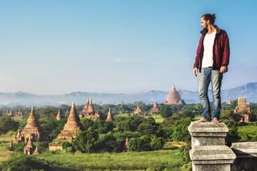 Traveler looking over the ancient ruins of Bagan, Myanmar (Burma).