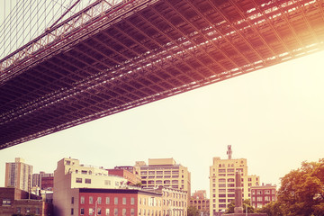 Under the Brooklyn Bridge at sunset, color toning applied, New York City, USA.