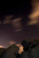 Night scene with rocks and stars in Costa Brava, Catalonia, Spain with long exposure technique