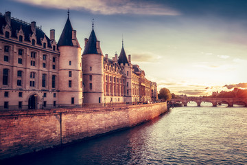 Beautiful skyline of Paris, France, with Conciergerie, Pont Neuf at sunset. Colourful travel background. Romantic cityscape.