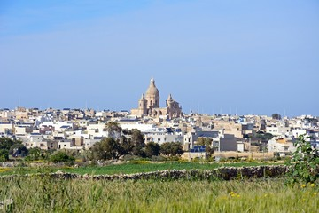 View across crop fields towards Siggiewi during the Springtime, Malta.